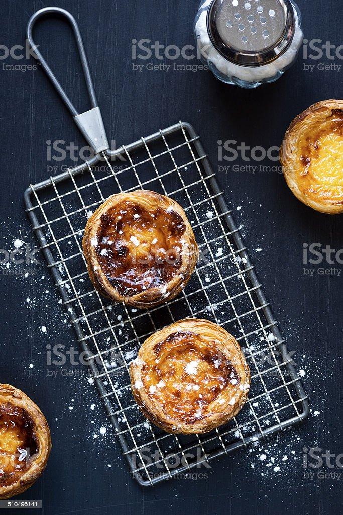 Pasteis de Nata or Custard Tarts with Powdered Sugar stock photo