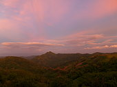 Pastel Blue and Pink of Sunset Sky over Mountain Range