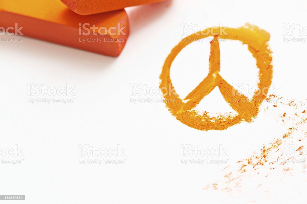 Pastel chalk draws orange peace sign stock photo