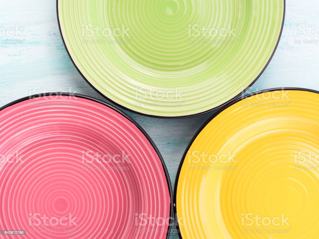 Pastel Color ceramic food plates top view background stock photo