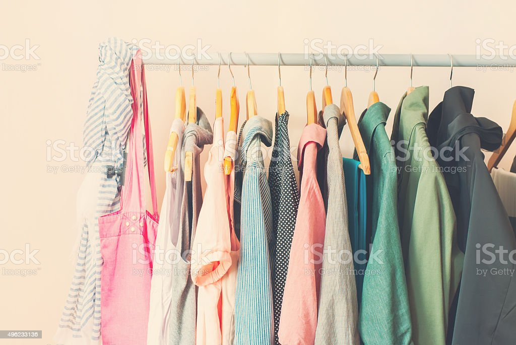 Pastel Color Female Clothes in a Row on Open Hanger stock photo