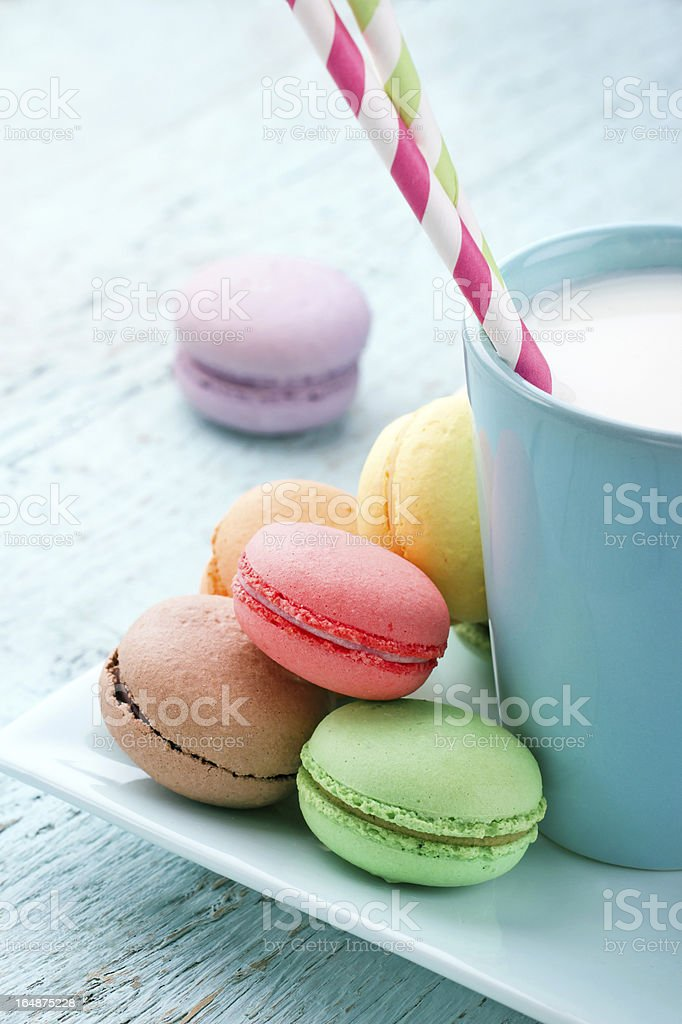 Pastel color macaroons and a cup of milk royalty-free stock photo