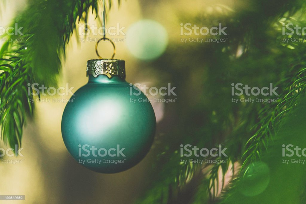 Pastel colored Christmas ornaments on Christmas tree branches stock photo