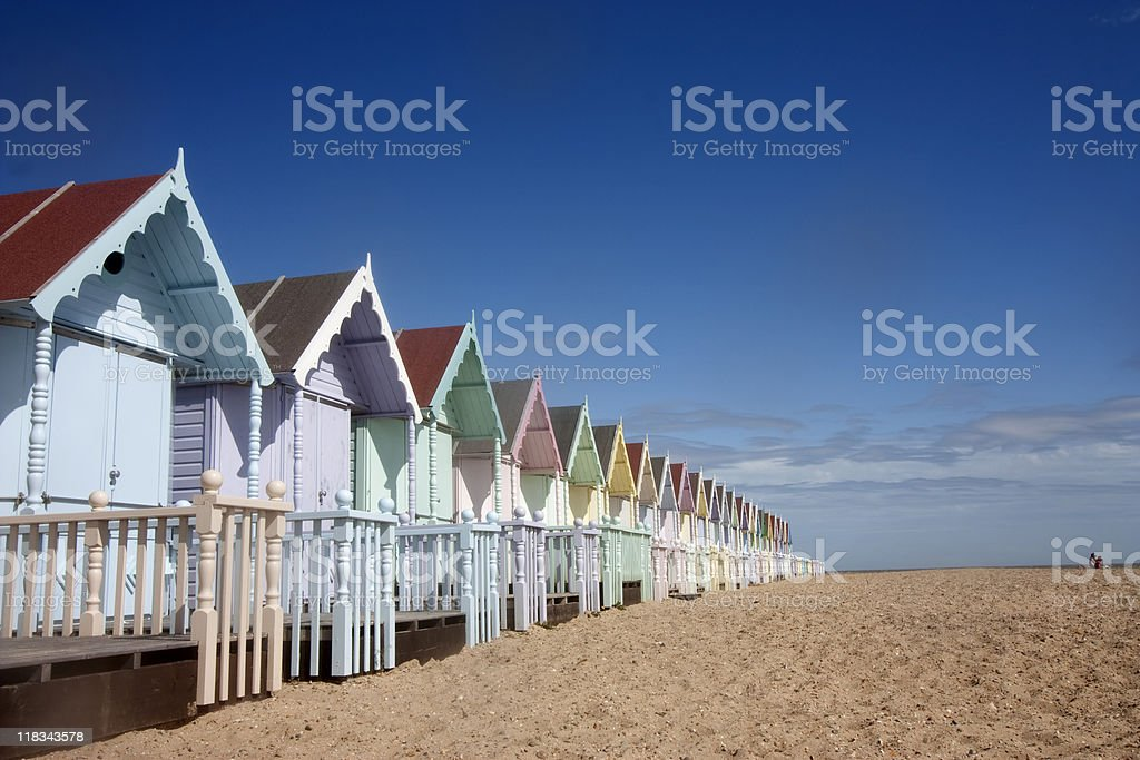 Pastel colored houses lines up on the beach royalty-free stock photo