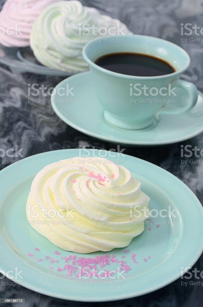 Pastel Colored Meringue Kisses in Four Flavors stock photo