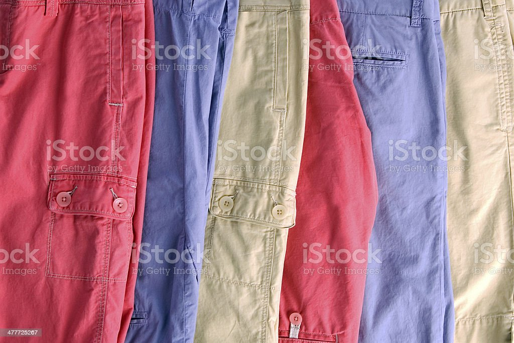pastel colored shorts in a row stock photo