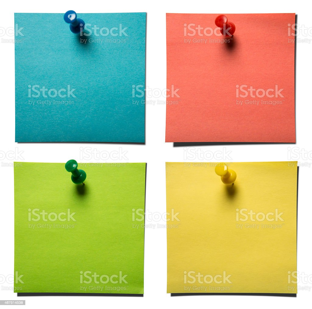 Pastel colored sticky notes pinned on wall stock photo