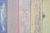 pastel colored wooden background.
