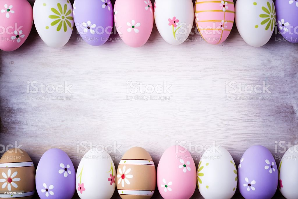 Pastel colors Easter eggs on a grey wooden background. stock photo