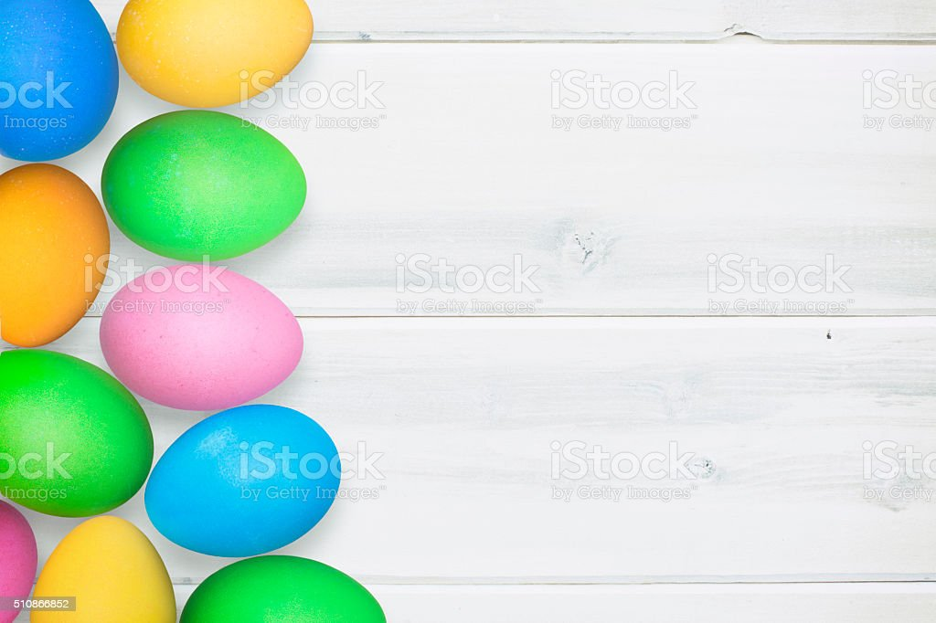 Pastel Easter Eggs on Vintage White Washed Background Rustic Theme stock photo
