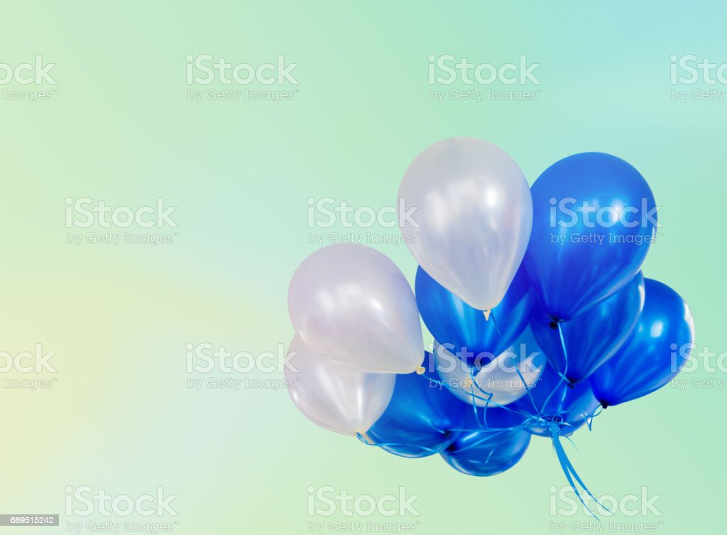 Pastel effected on balloons floating with copy space stock photo