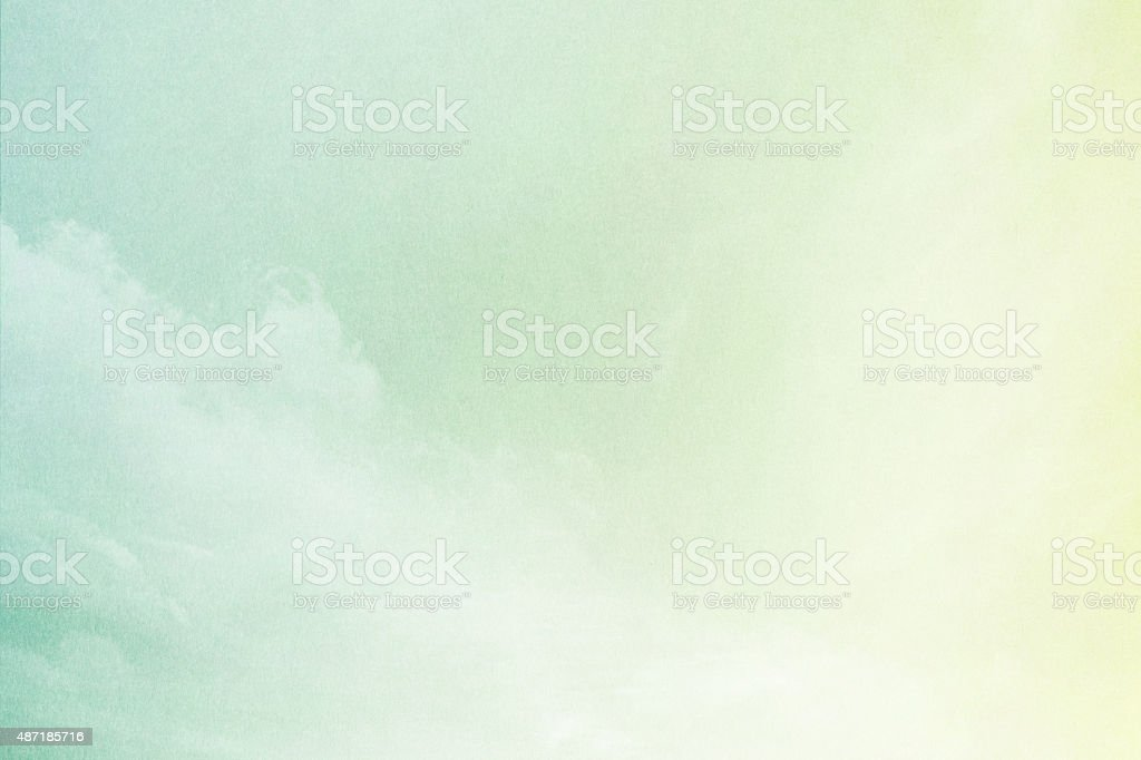 pastel gradient color with grunge paper texture and cloudscape stock photo