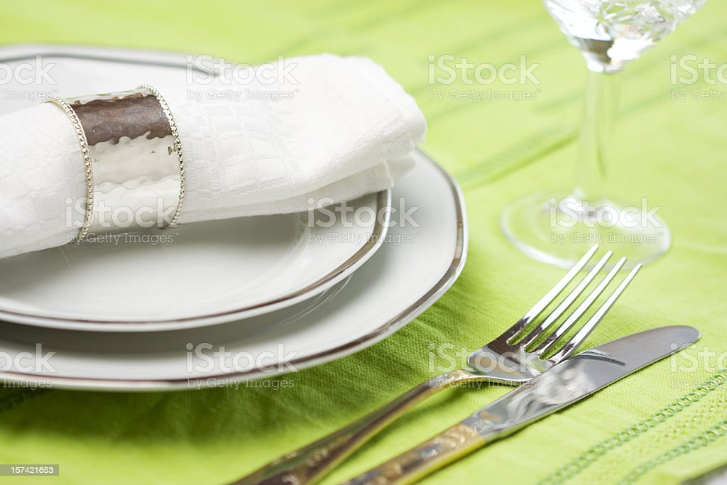 A pastel green colored dinner place setting royalty-free stock photo