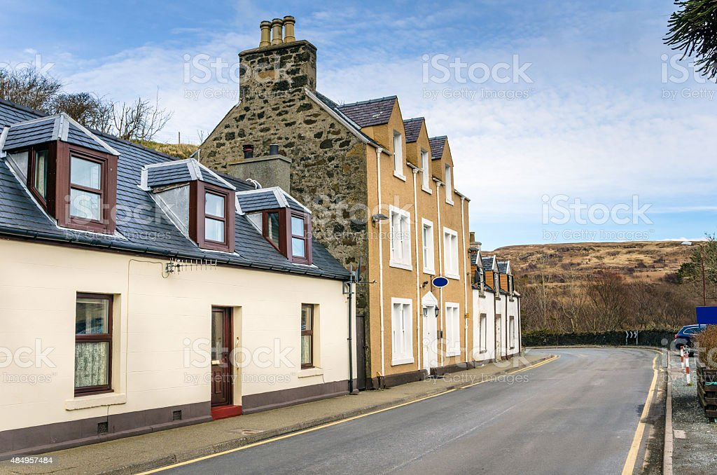 Pastel Painted Houses along a Street in Scotland stock photo