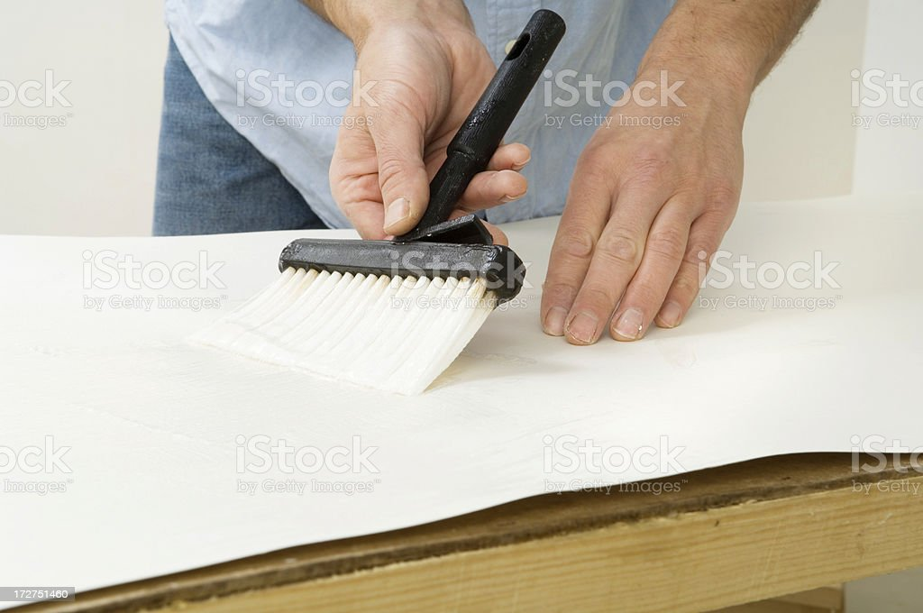 Pasting wallpaper royalty-free stock photo