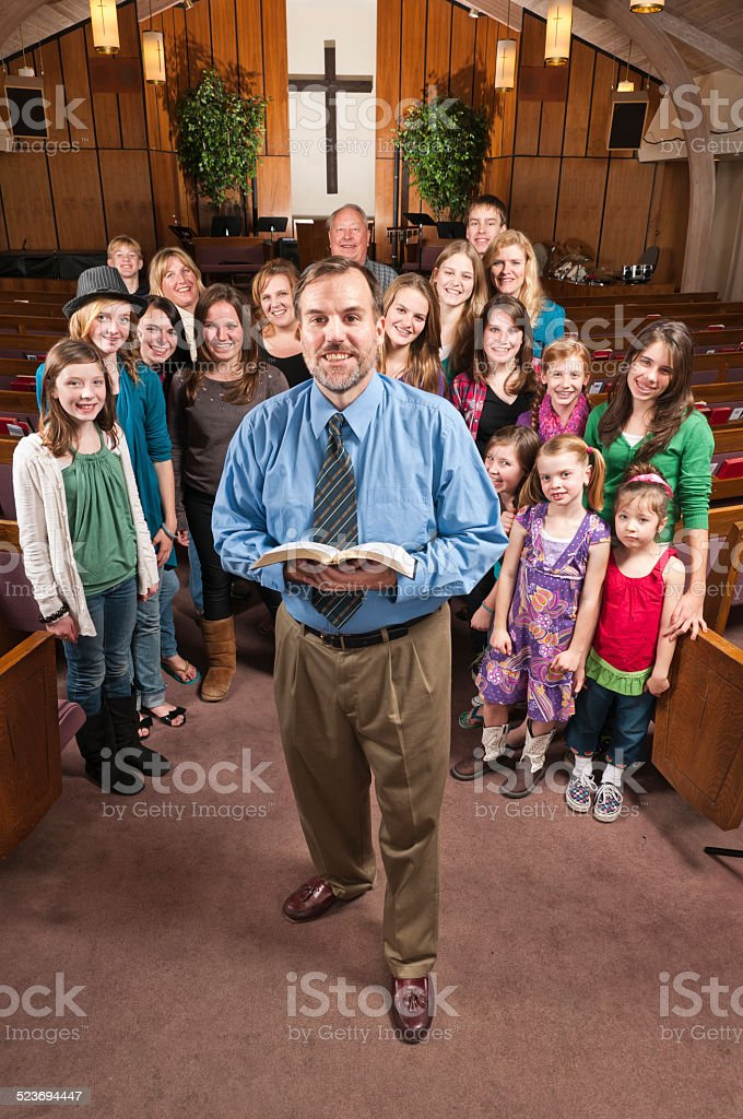 Pastor with His People Behind stock photo