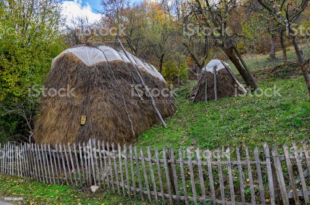 Pastoral landscape in garden with bundle of hay, Lakatnik stock photo