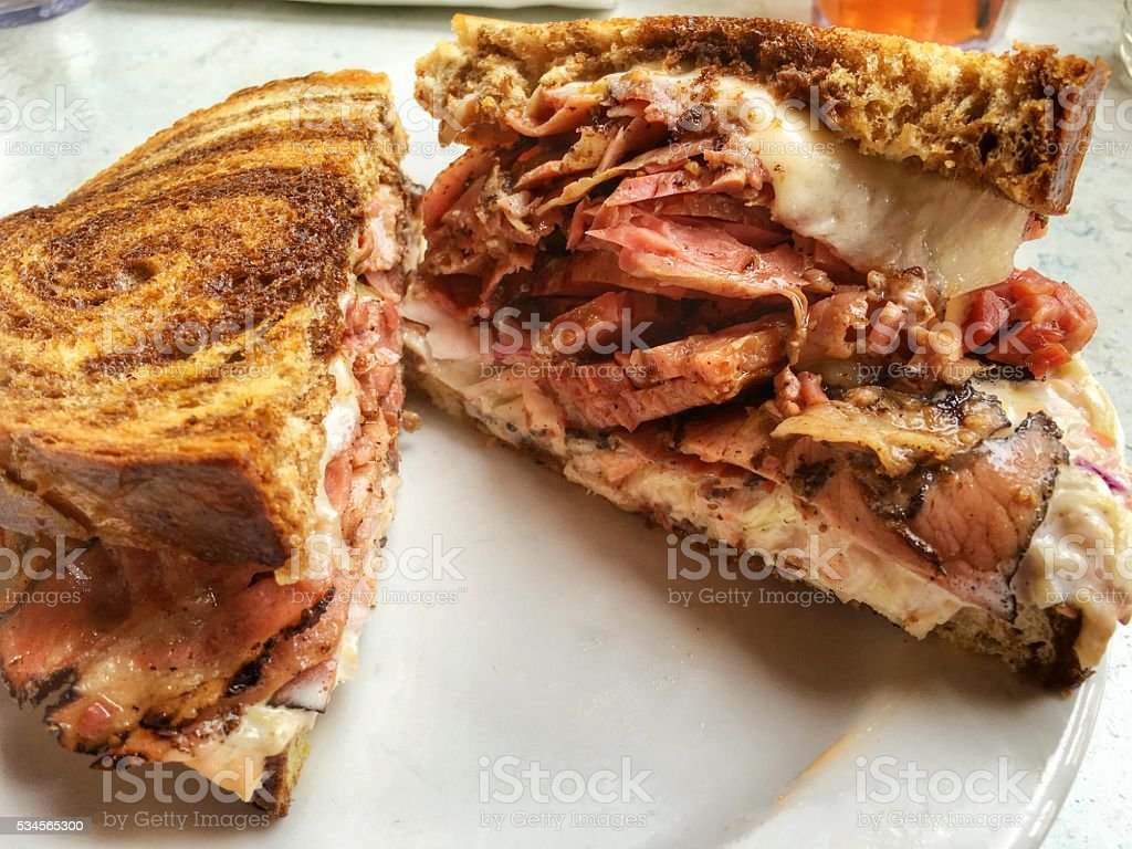 Pastrami and corned beef Reuben sandwich stock photo