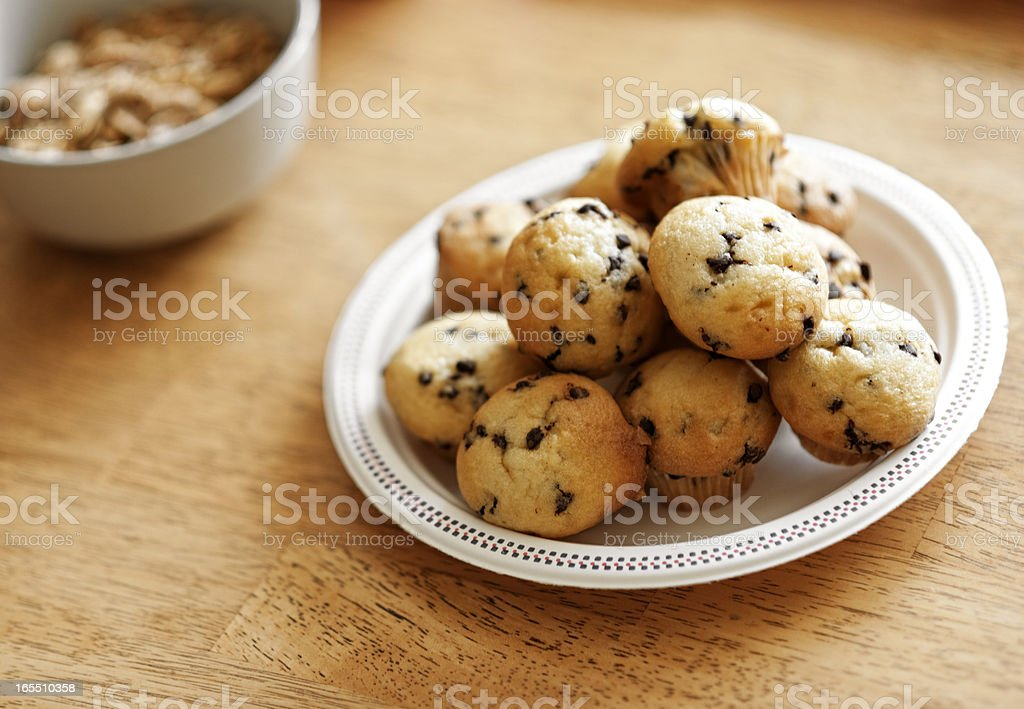 Pastries and Muffins on Rustic Table royalty-free stock photo