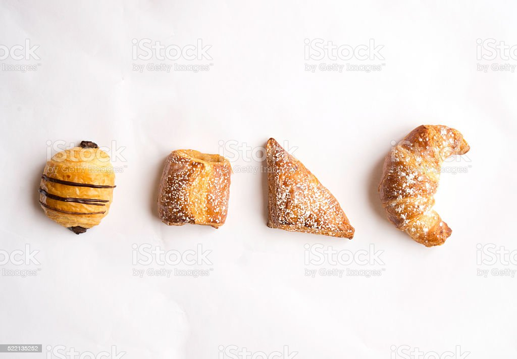 Pastries on a white paper stock photo