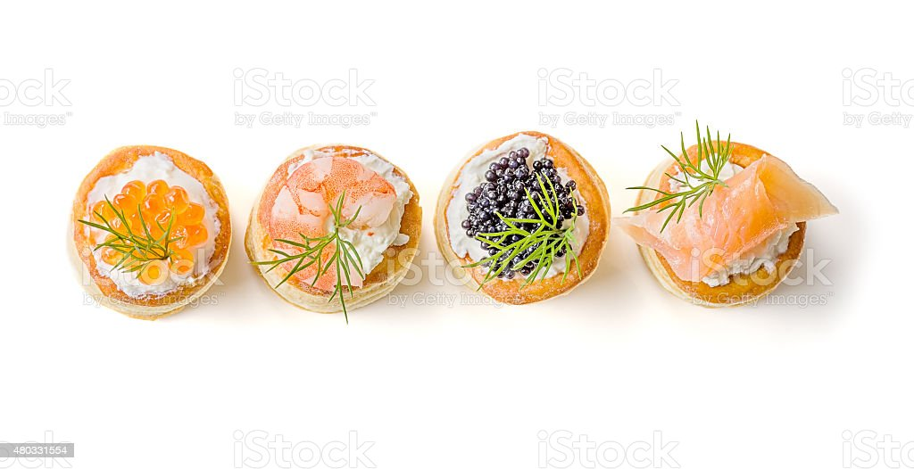 Pastries with salmon, caviar and shrimp stock photo