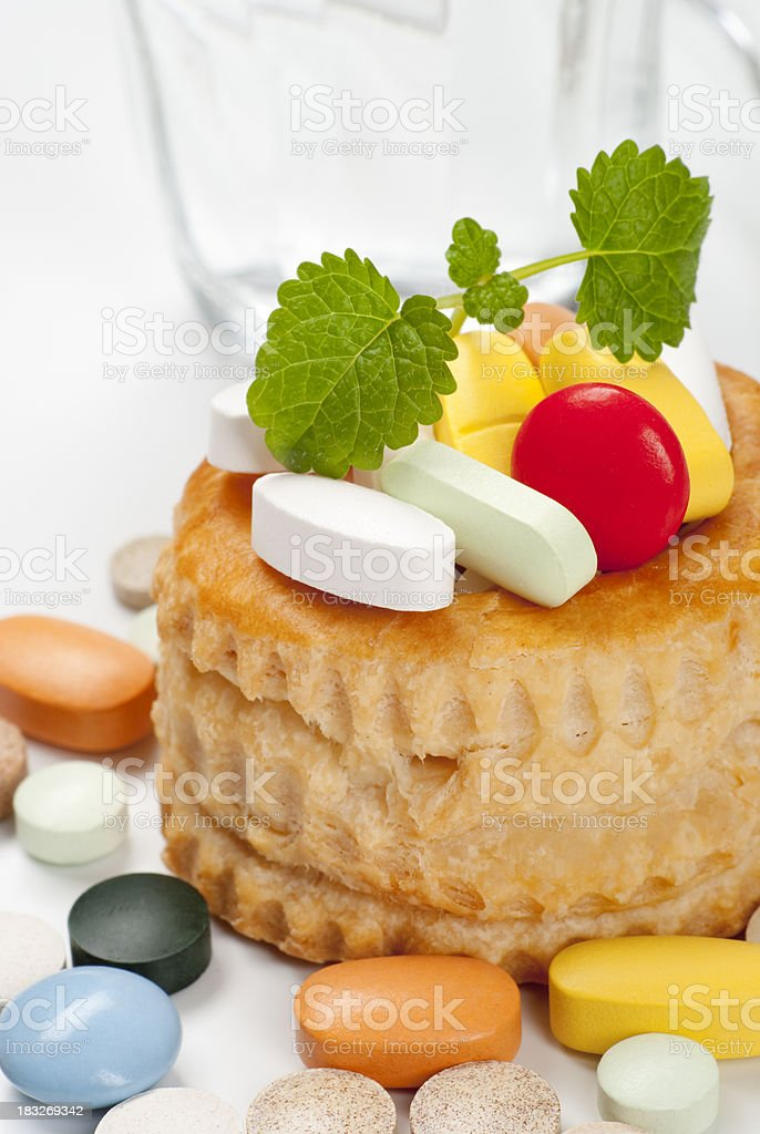 Pastry and pills royalty-free stock photo