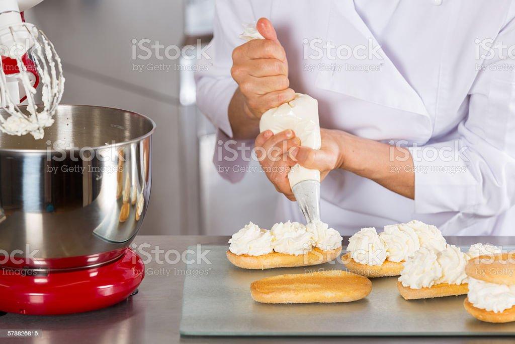 Pastry chef decorating stock photo