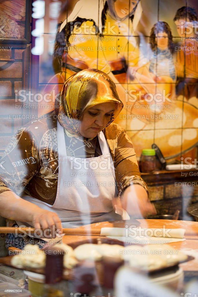 Pastry chef kneading dough with rolling pin stock photo