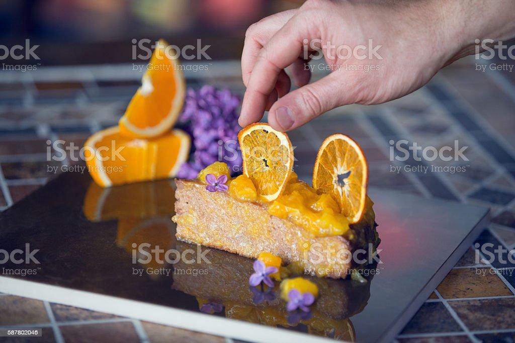 Pastry chef styling sponge cake stock photo