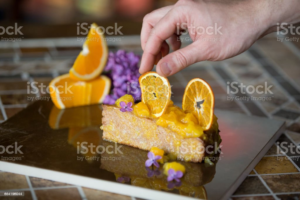 Pastry chef styling sponge cake stock photo
