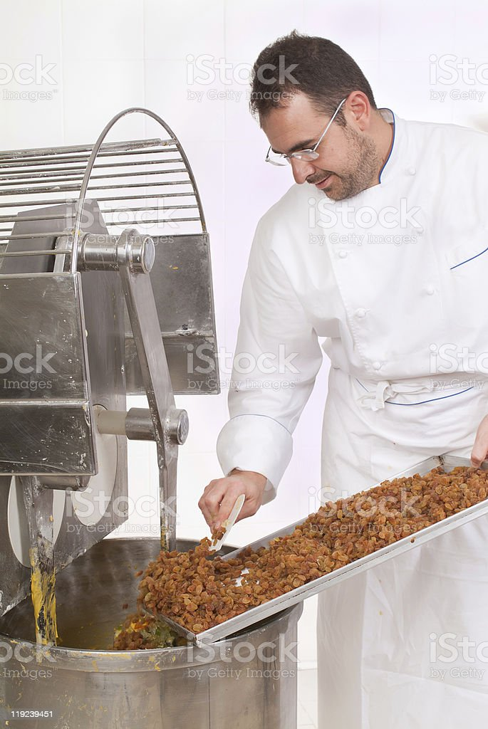 Pastry chef who prepares the cake royalty-free stock photo