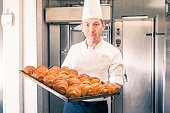 Pastry chef with his freshly baked croissants
