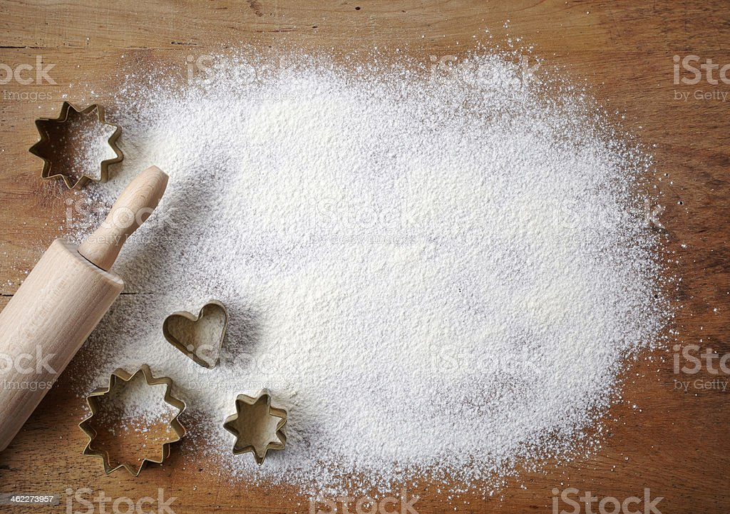 Pastry cutters with rolling pin and sugar stock photo