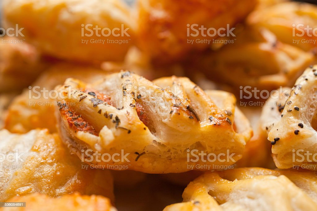 Pastry in a pile, sobrassada puff pastry stock photo