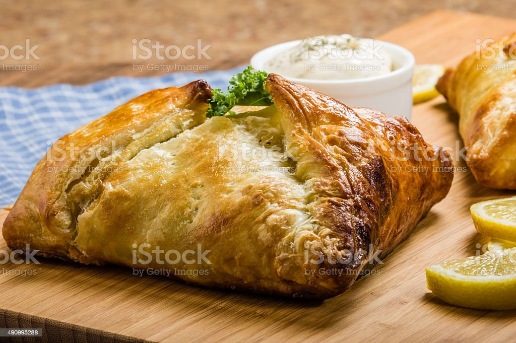 Pastry puff wrapped salmon fillet stock photo