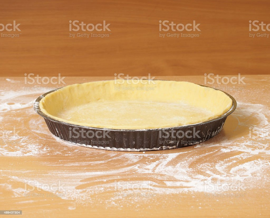 Pastry ready to be filled. Making Apple Pie Tart Series. stock photo