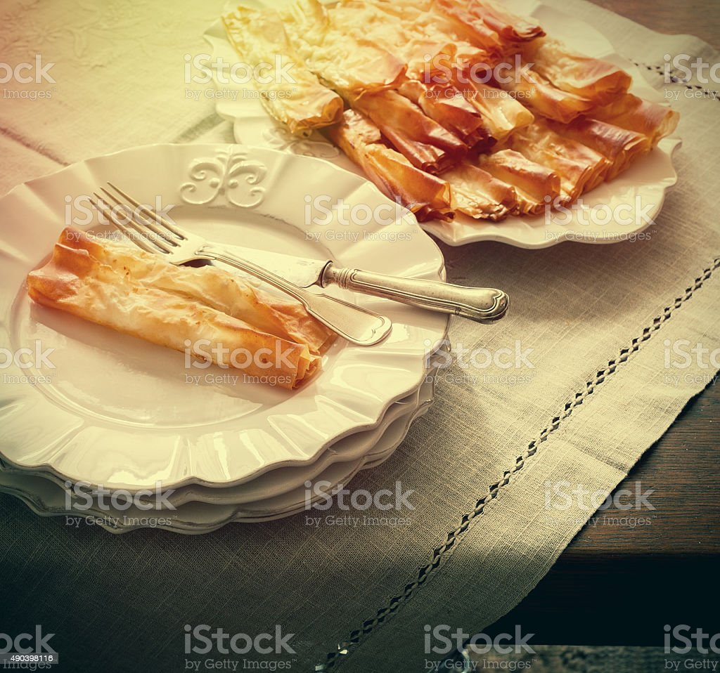 Pastry served in white plates, vintage effect stock photo