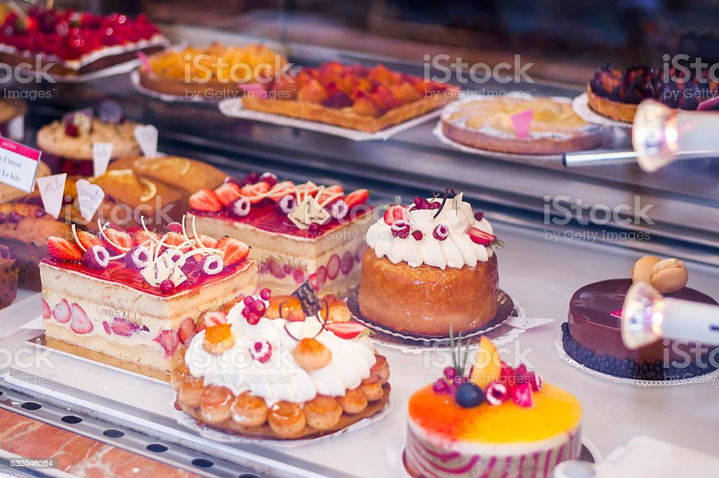 Pastry shop with variety of cakes with fruits and berries stock photo