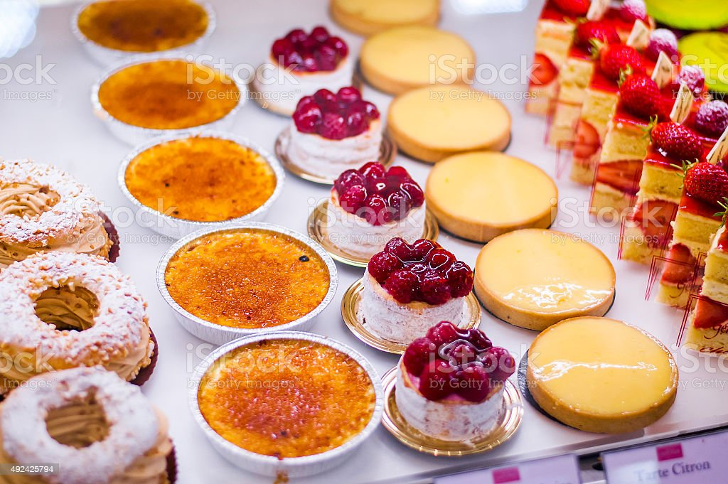 Pastry shop with variety of donuts, Creme brulee, cakes stock photo