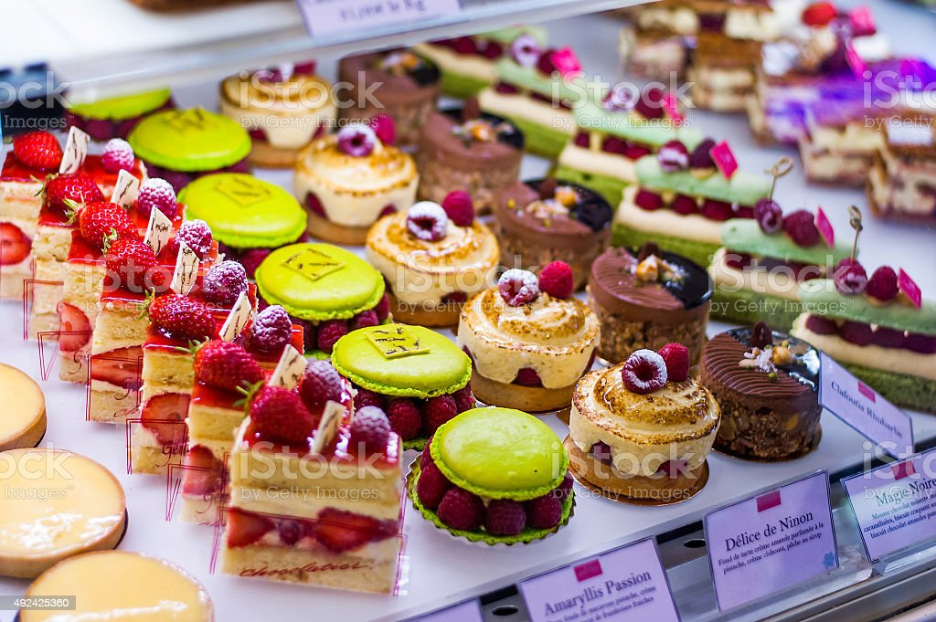 Pastry shop with variety of donuts, muffins, creme brulee, cakes stock photo