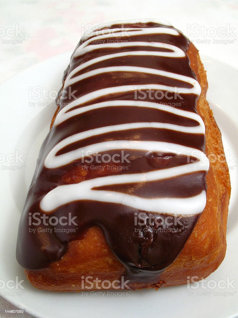 Pastry With Chocolate and White Icing royalty-free stock photo