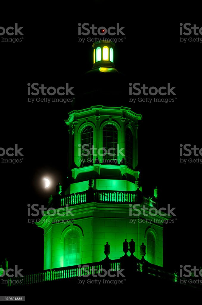 Pat Neff Tower in Green with Eclipse of Moon stock photo