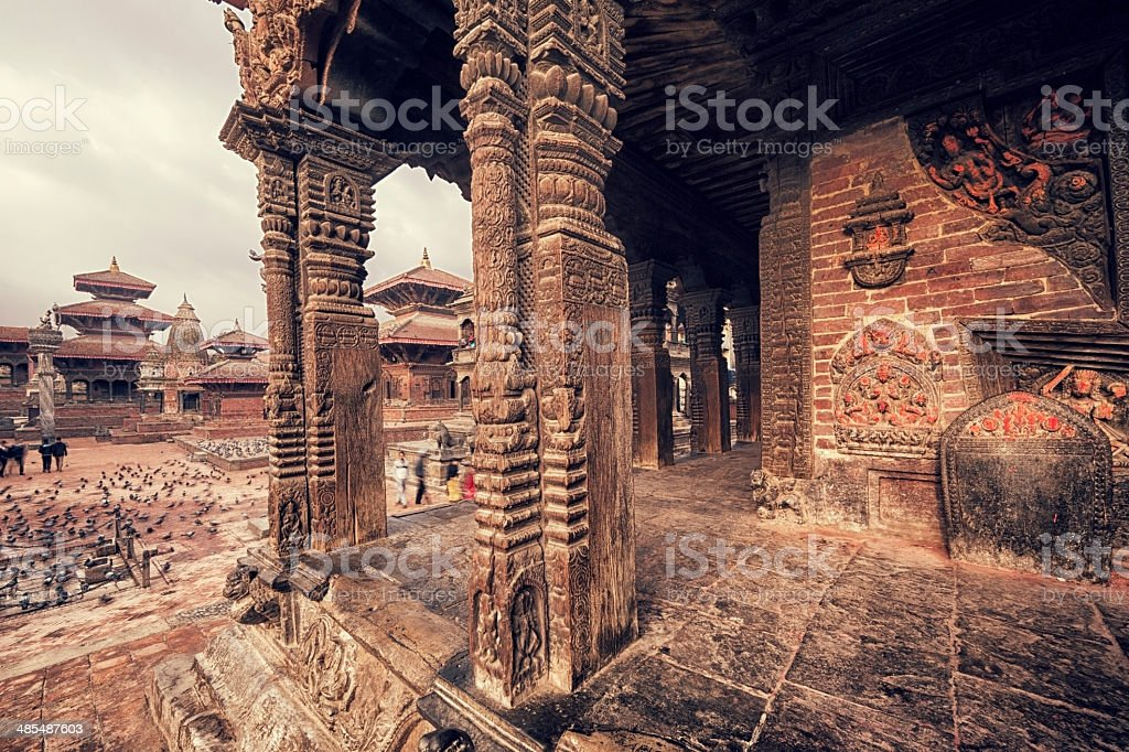 Patan Durbar Square and Columns of a Temple, Kathmandu, Nepal royalty-free stock photo