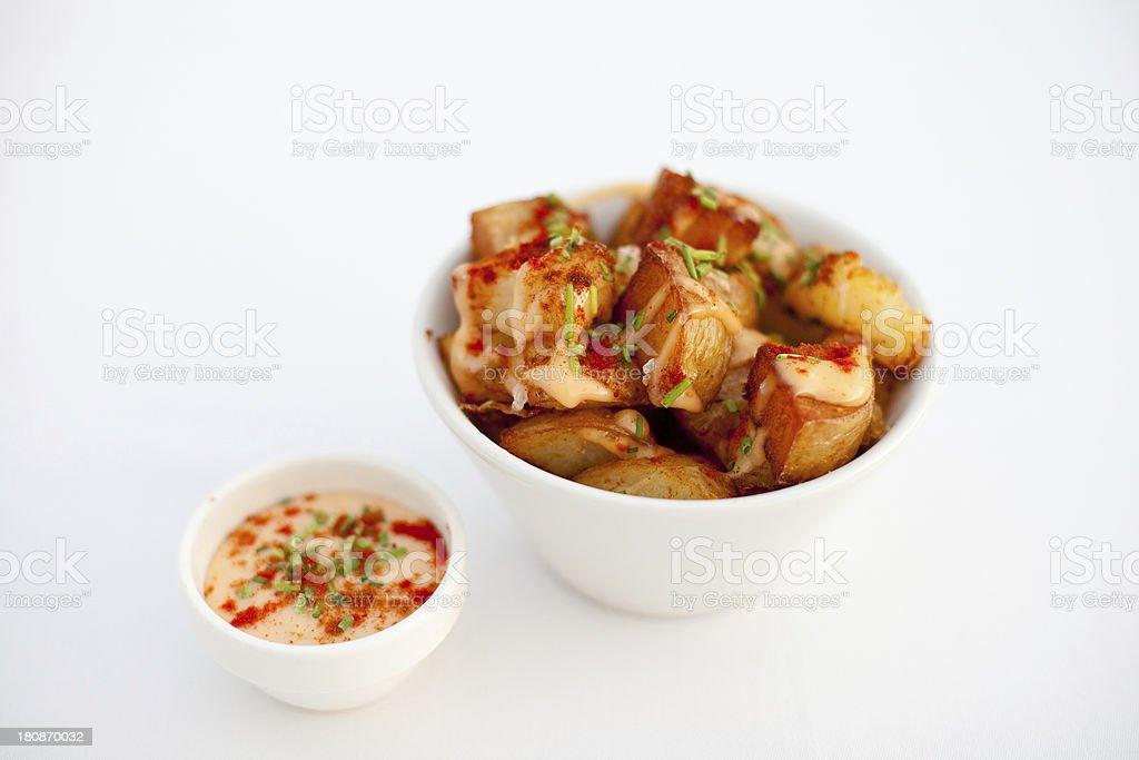 Patatas bravas typical Spanish potato tapas with dip royalty-free stock photo
