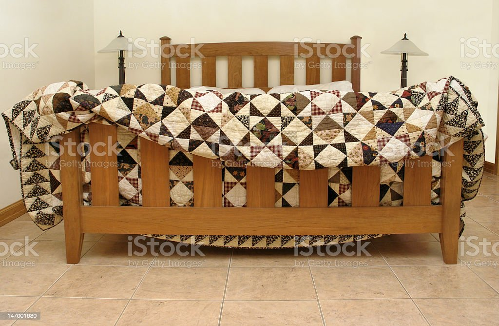 Patchwork quilt displayed on bed royalty-free stock photo