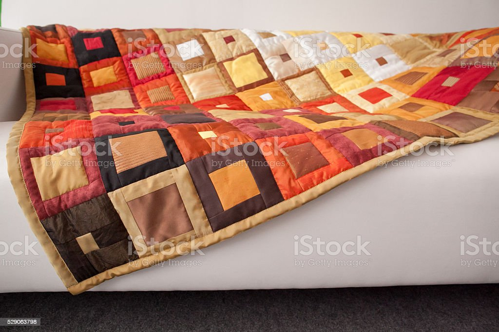 Patchwork quilt. Part of patchwork quilt as background. Handmade stock photo
