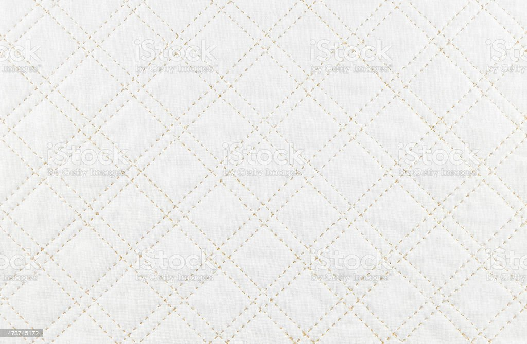 A patchwork quilt pattern with broken lines stock photo
