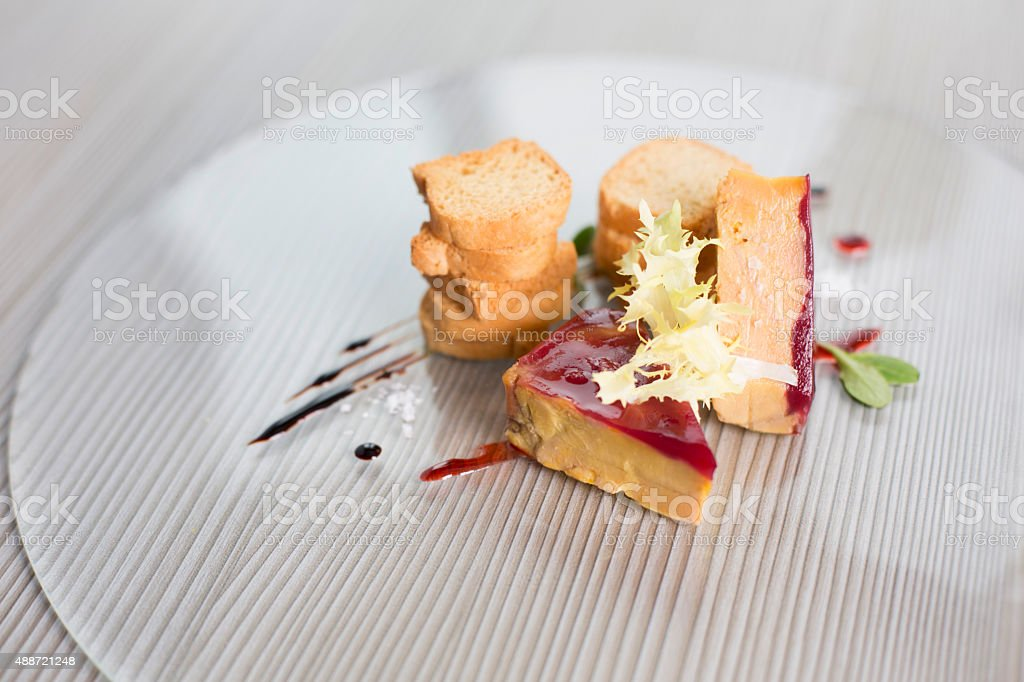 Pate de foie with raspberry coulis stock photo