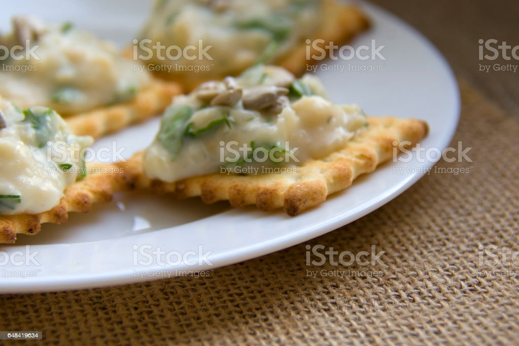 pate with frigole, on small crackers stock photo