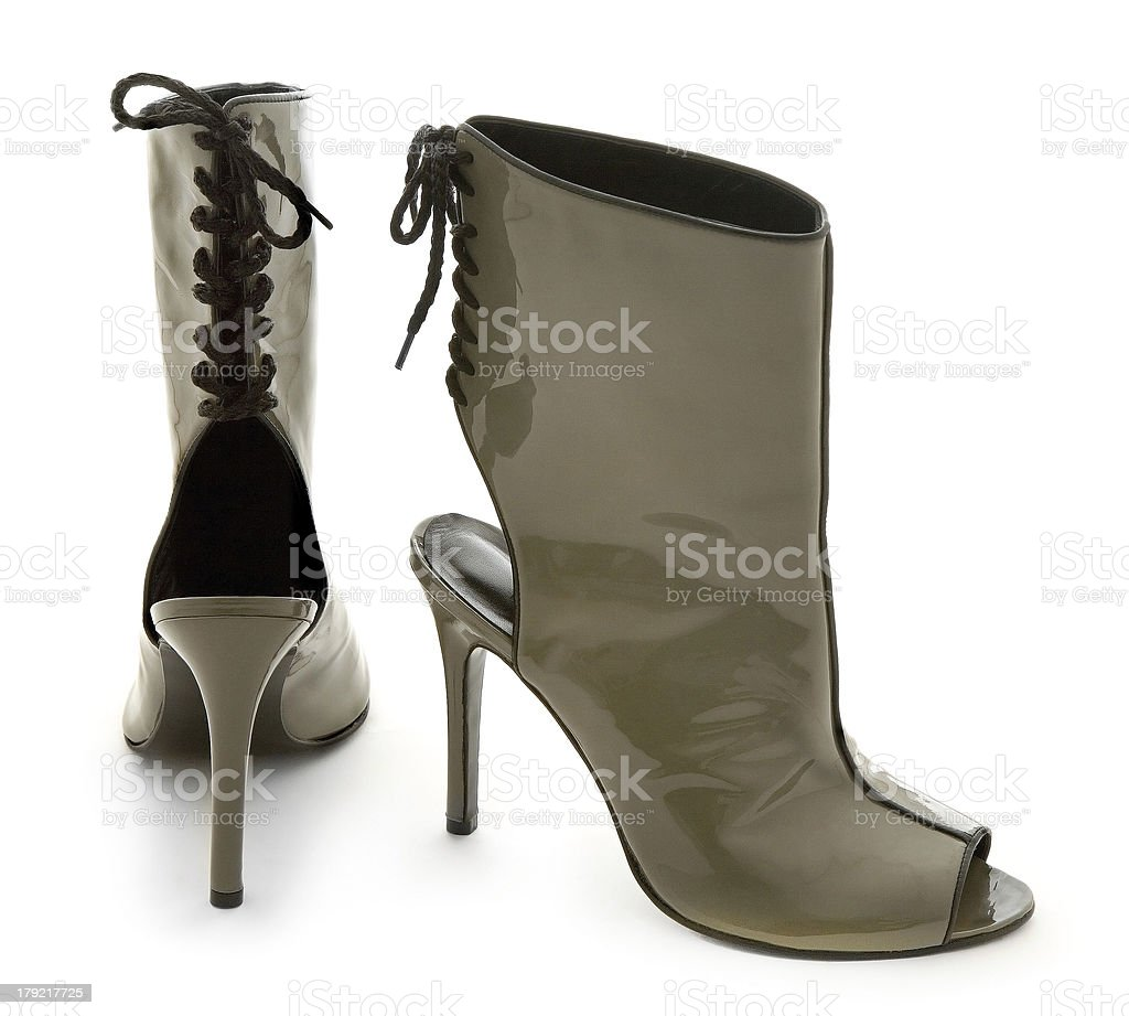 Patent leather peep-toe open-back back lace-up ankle boots stile stock photo